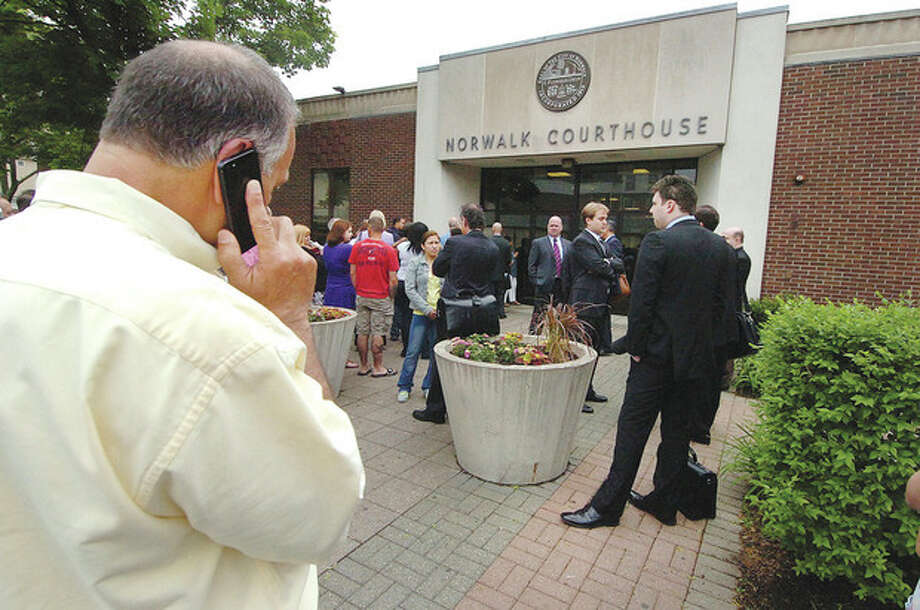 People wait outside the Norwalk Superior Court. / 2013 The Hour Newspapers