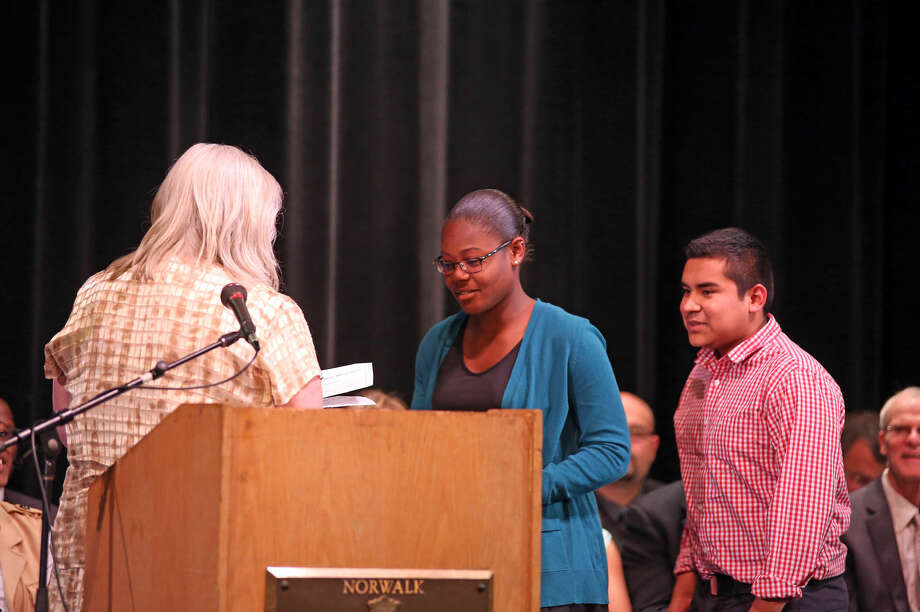 Courtney Tapper accepts The Wilkerson Scholarship during Norwalk High School's Awards Program Thursday evening. Hour Photo / Danielle Calloway