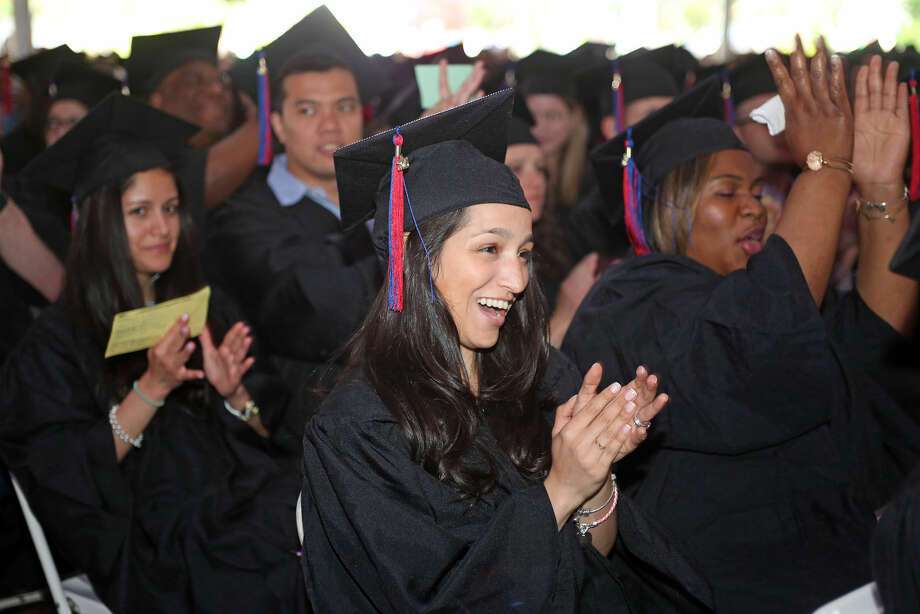 Mitherleyne Lima applauds during Norwalk Community College's 53rd Annual Commencement Exercises Thursday afternoon. Hour Photo / Danielle Calloway