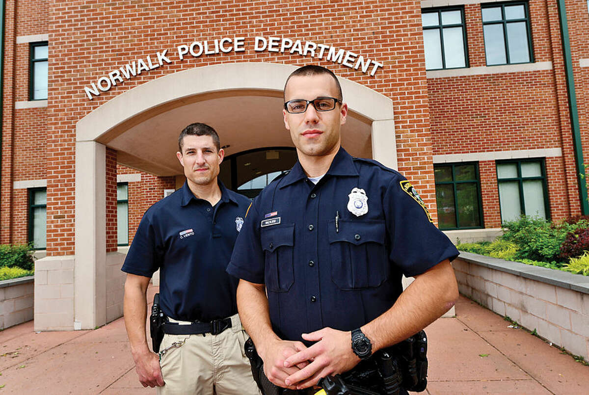 Hour photo / Erik Trautmann Norwaslk Police Department's newest recruit Joe Macaluso, right, and his training officer, Corey Vento.
