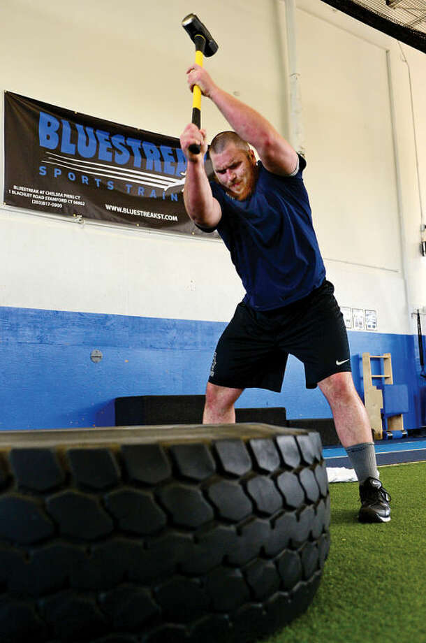 Hour photo / Erik Trautmann Former Norwalk High School football player DJ Morrell who may be drafted in this week's NFL Draft works out at Blue Streak fitness club in Stamford Tuesday morning.
