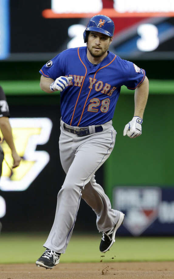 New York Mets' Daniel Murphy rounds second base after hitting a solo home run against the Miami Marlins during the first inning of a baseball game in Miami, Monday, May 5, 2014. (AP Photo/Alan Diaz)