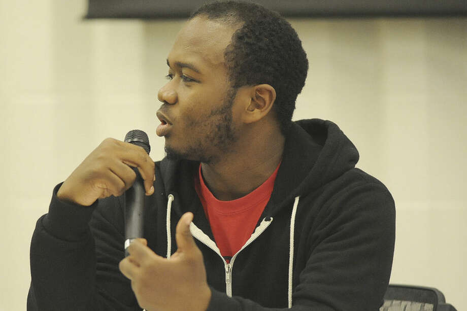 "Chris Hayes from Western Connecticut State College speaks on the panel at Norwalk High School Wednesday night where the topic of discussion was ""What to Do if you are Stopped by the Police"" Hour photo/Matthew Vinci"