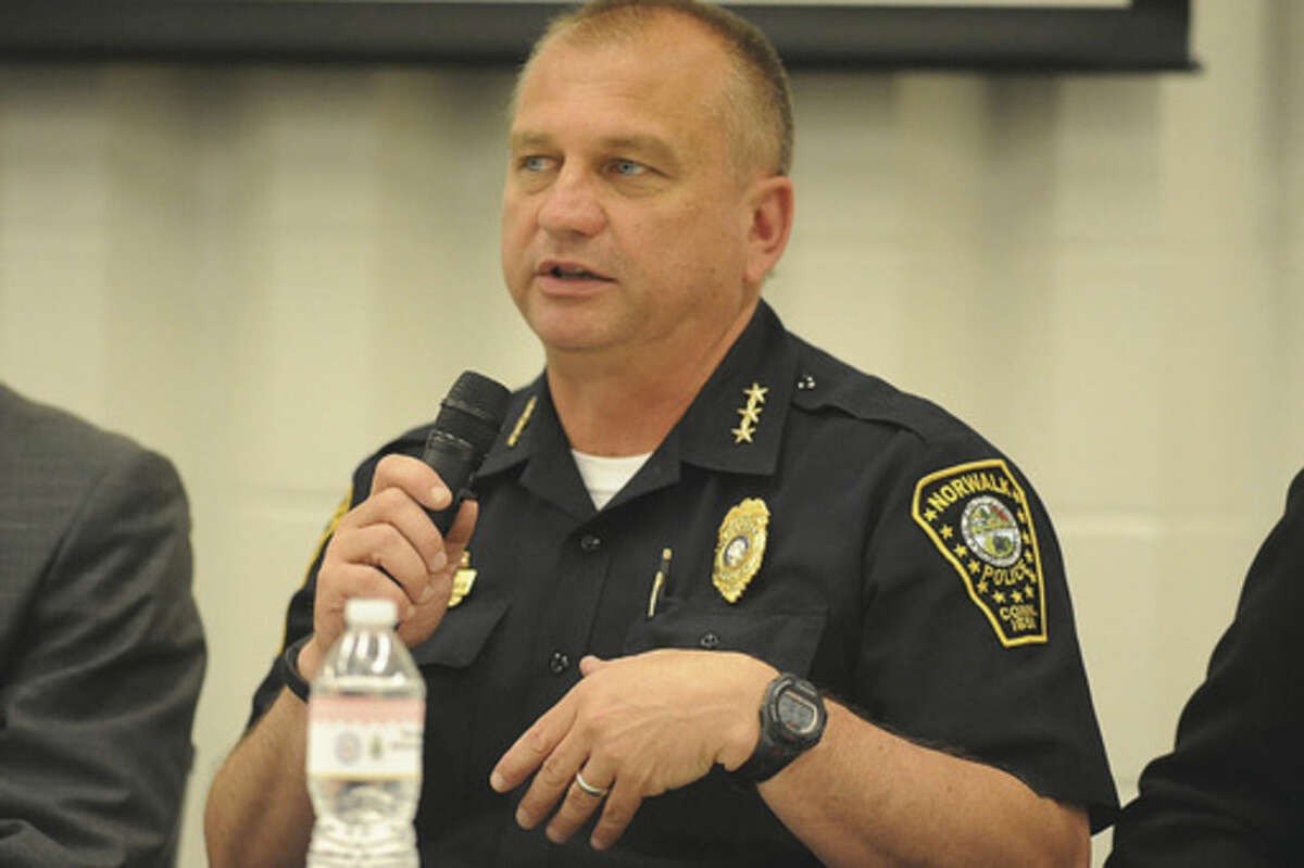 """Norwalk Police Chief Thomas Kulhawik speaks Wednesday night on a panel at Norwalk High School about """"What to do if you are stopped by Police"""" Hour photo/Matthew Vinci"""