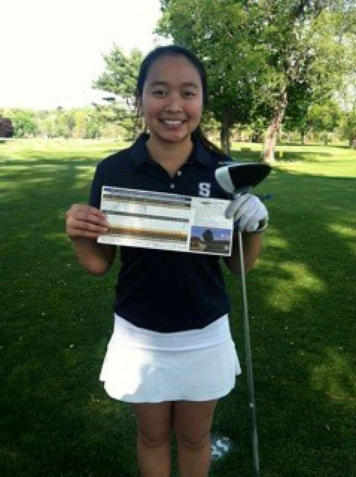 Staples senior Anelise Browne holds her scorecard after firing a 35 to set a new high school female record at Longshore on Thursday in a match with Ludlowe and Ridgefield.