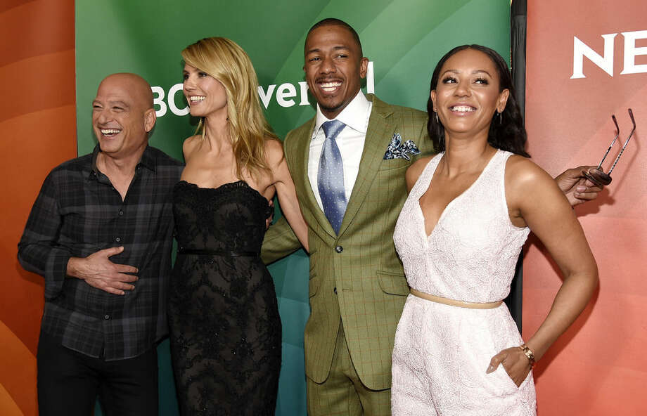 "FILE - In this April 2, 2015 file photo, Howie Mandel, from left, Heidi Klum, Nick Cannon and Melanie Brown from ""America's Got Talent,"" arrive at the NBC Universal Summer Press Day in Pasadena, Calif. The 10th season premieres Tuesday, May 26, at 8 p.m. ET. (Photo by Chris Pizzello/Invision/AP, File)"