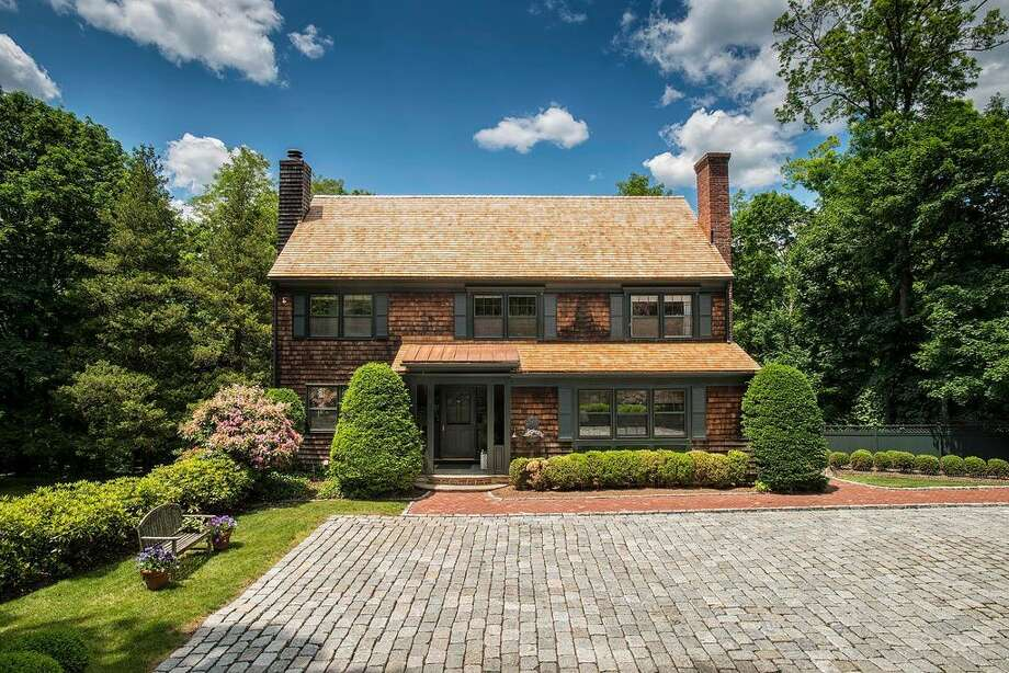 13 Meadow Wood Dr, Greenwich, CT 06830 - 5 beds 3.5 baths 3,465 sqft. Trending feature: Stone wall. Other features: Built-in bar, new roof,  walking distance to Belle Haven Waterfront Club