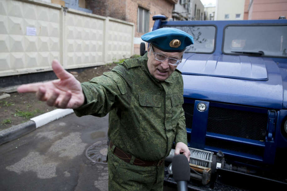 Russian lawmaker Vladimir Zhirinovsky, dressed as paratrooper, gestures during meeting with press as he gives his vehicle, a GAZ-2975 Tigr, to pro-Russian activists from eastern Ukraine in Moscow, Russia, Tuesday, May 6, 2014. (AP Photo/Pavel Golovkin)