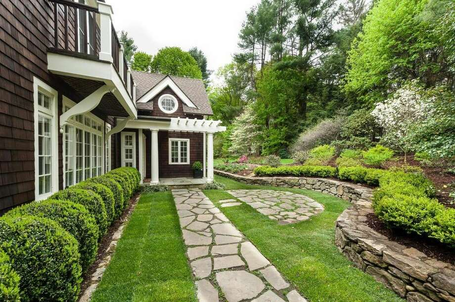 39 Lambert Rd, New Canaan, CT 06840 - 5 beds 5 baths 4,559 sqft. Features: Picturesque views of the Five Mile River, pond, landscaped lawn
