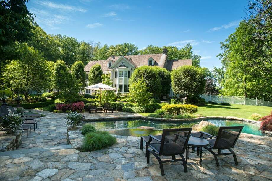 709 West Rd, New Canaan, CT Price: $5,995,000 Features: Pool house, Stone terraces, Infinity pool, Spa, Featured on the 2015 Secret Garden Tour