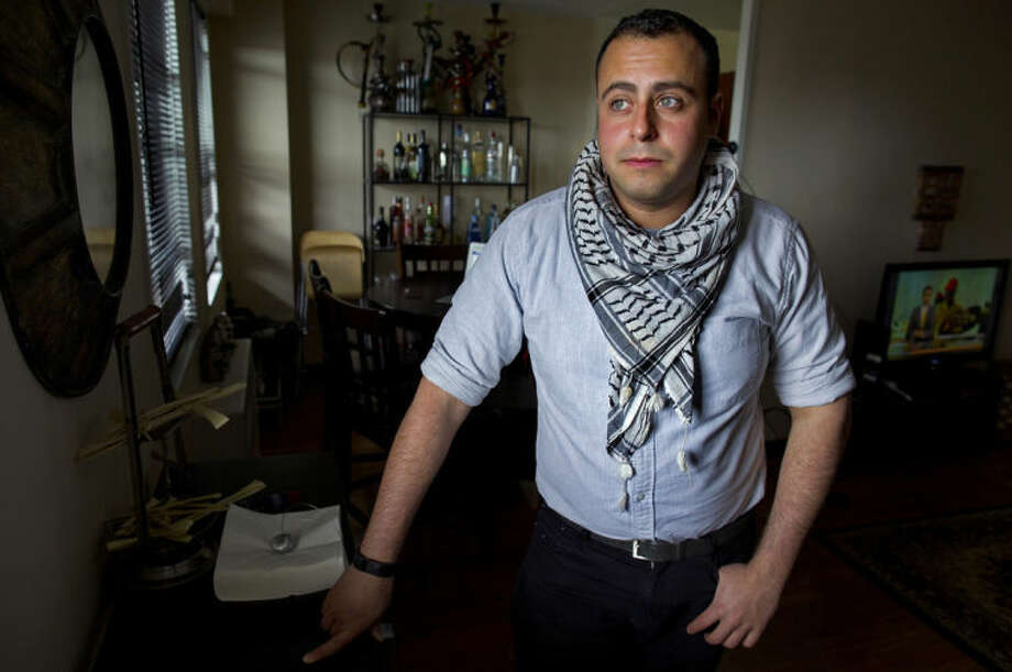 In this Sunday, May 4, 2014 photo, Bashar Makhay stands for a photo in his apartment in the Brooklyn borough of New York. Makhay, who is Iraqi-American and gay, said he created Tarab, a series of parties, beach gatherings and other events for LGBT Arabs and Middle Easterners in New York City. The Tarab program will celebrate its second anniversary with an event May 10. (AP Photo/Craig Ruttle)