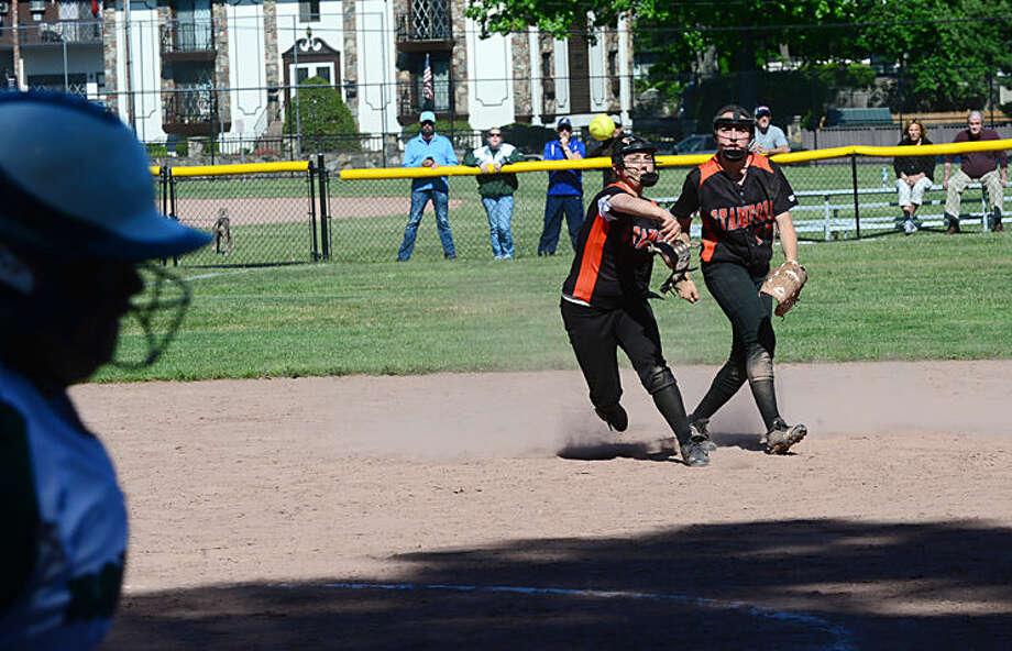 Hour photo / Erik Trautmann Norwalk High School softball plays Stamford in their FCIAC semi -final game in Stamford Saturday.