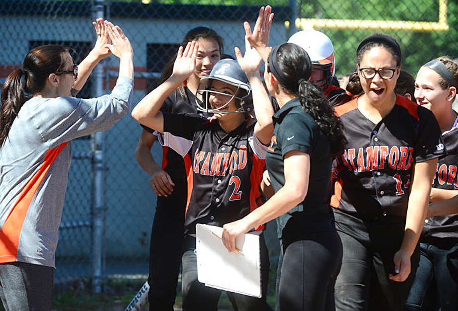 Hour photo / Erik Trautmann Norwalk High School softball plays Stamford in their FCIAC semi -final game in Stamford Saturday.