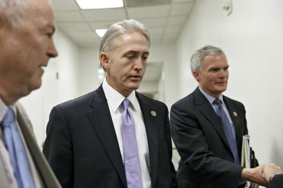 Rep. Trey Gowdy, R-S.C., center, walks with Rep. Dana Rohrabacher, R-Calif., left, and Rep. Bob Latta, R-Ohio, right, as they arrive for a House Republican Conference meeting at the Capitol in Washington, Wednesday, May 7, 2014. Speaker of the House John Boehner has tapped Gowdy, a former federal prosecutor, to chair a special select committee to investigate the attack on the U.S. diplomatic outpost in Benghazi, Libya, that killed the ambassador and three other Americans. Benghazi resonates with Republicans and remains a rallying cry with conservatives whose votes are crucial to the GOP in November's historically low-turnout midterm elections. (AP Photo/J. Scott Applewhite)