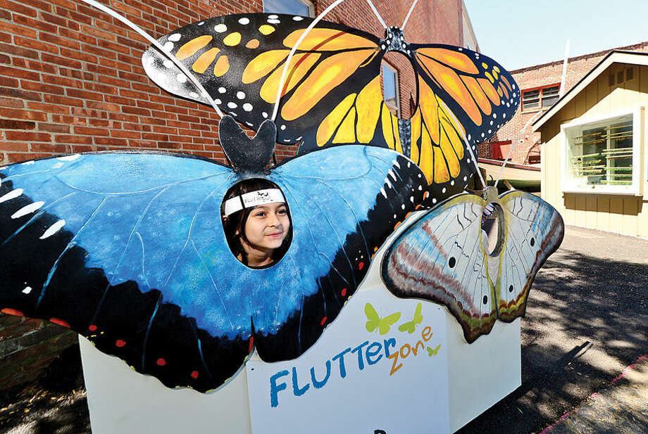 Hour photo / Erik Trautmann Visitors at the Maritime Aquarium Saturday including 6 year old Sienna Syed enjoy the abundance of butterflies on the opening day of the aquarium's new exhibit, Flutter Zone.