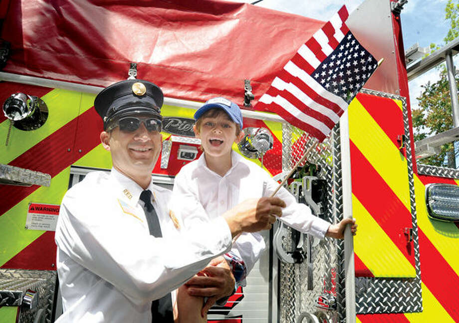 Mark Pinzon with the Rowayton Fire department and his son Jackson 7, at the annual Memorial Day Parade on Sunday. Hour photo/Matthew Vinci