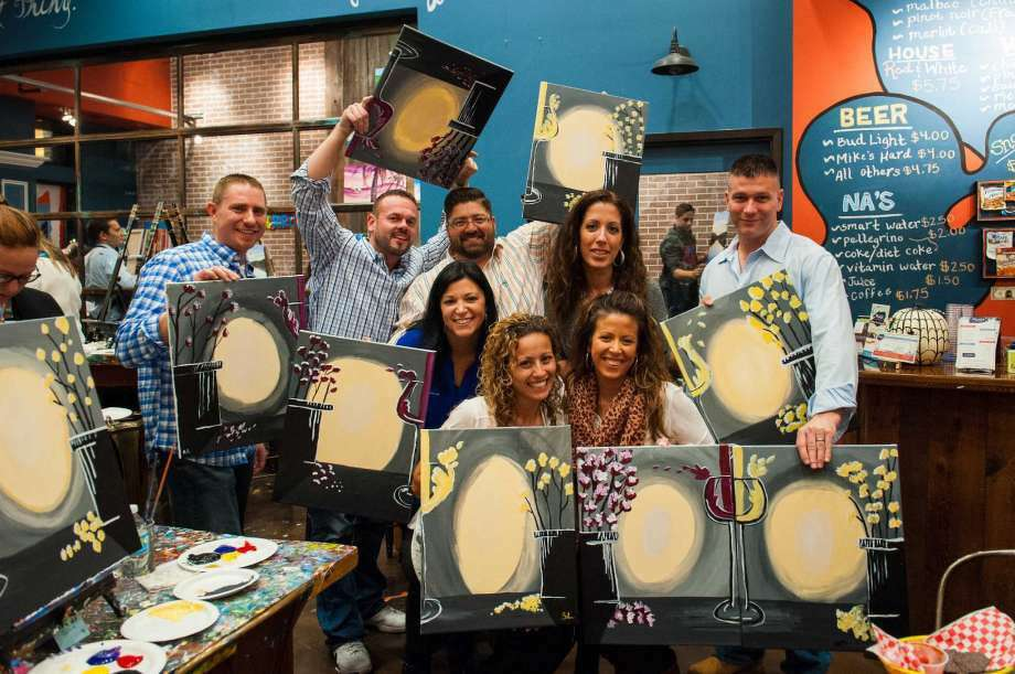 Friends socialize, have a drink and paint at Muse Paintbar in Norwalk. (Photo: Contributed Photo)