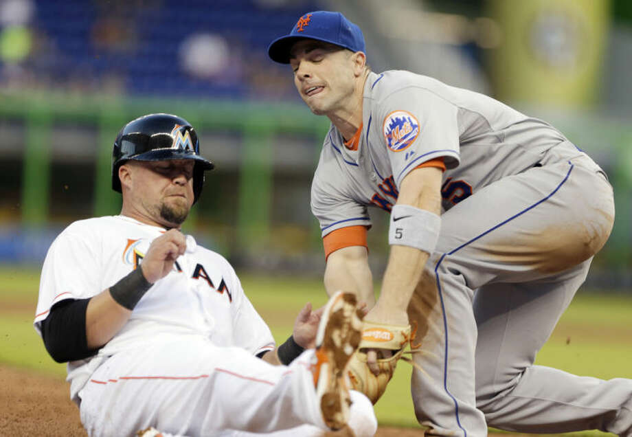 New York Mets third baseman David Wright, right, tags out Miami Marlins' Casey McGehee as he slides into third base during the inning of a baseball game, Tuesday, May 6, 2014, in Miami. (AP Photo/Wilfredo Lee)