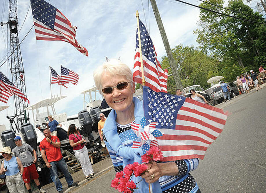 Bonnie Clarey enjoys the Rowayton Memorial Day Parade on Sunday. Hour photo/Matthew Vinci