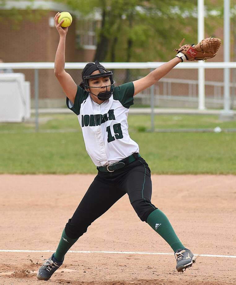 Norwalk pitcher Brianny Garcia fires a pitch to the plate during her six innings of scoreless softball in the Bears' 21-3 win over Brien McMahon on Saturday.