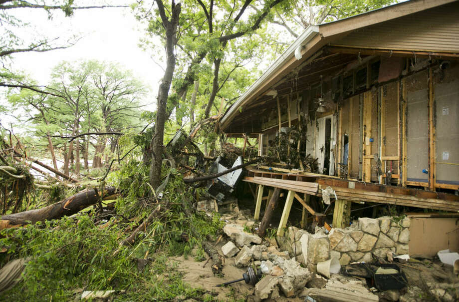 A cabin is damaged at the Rio Bonito Resort on the banks of the Blanco River in Wimberley, Texas, Sunday May 24, 2015. Flooding in Texas and Oklahoma has led to numerous evacuations. (Jay Janner/Austin American-Statesman via AP) AUSTIN CHRONICLE OUT, COMMUNITY IMPACT OUT, INTERNET AND TV MUST CREDIT PHOTOGRAPHER AND STATESMAN.COM, MAGS OUT