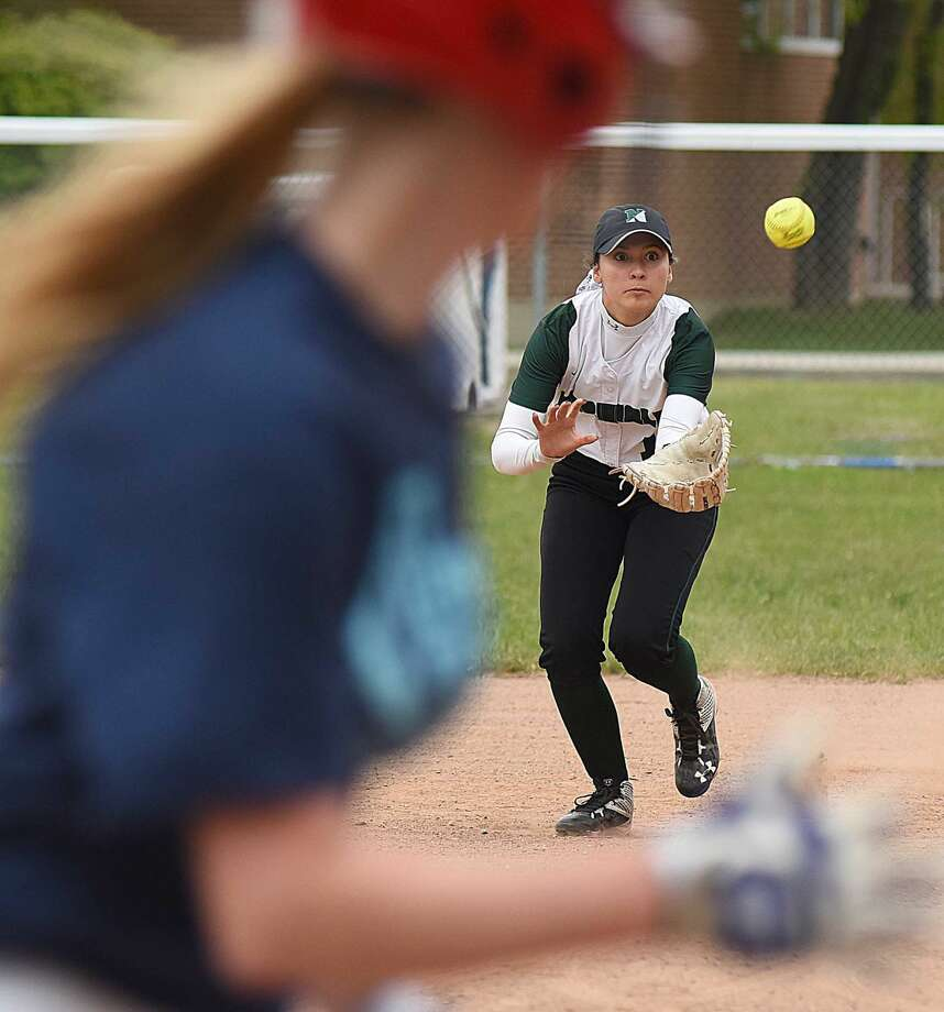 Action from Tuesday's Norwalk-McMahon softball game in Norwalk