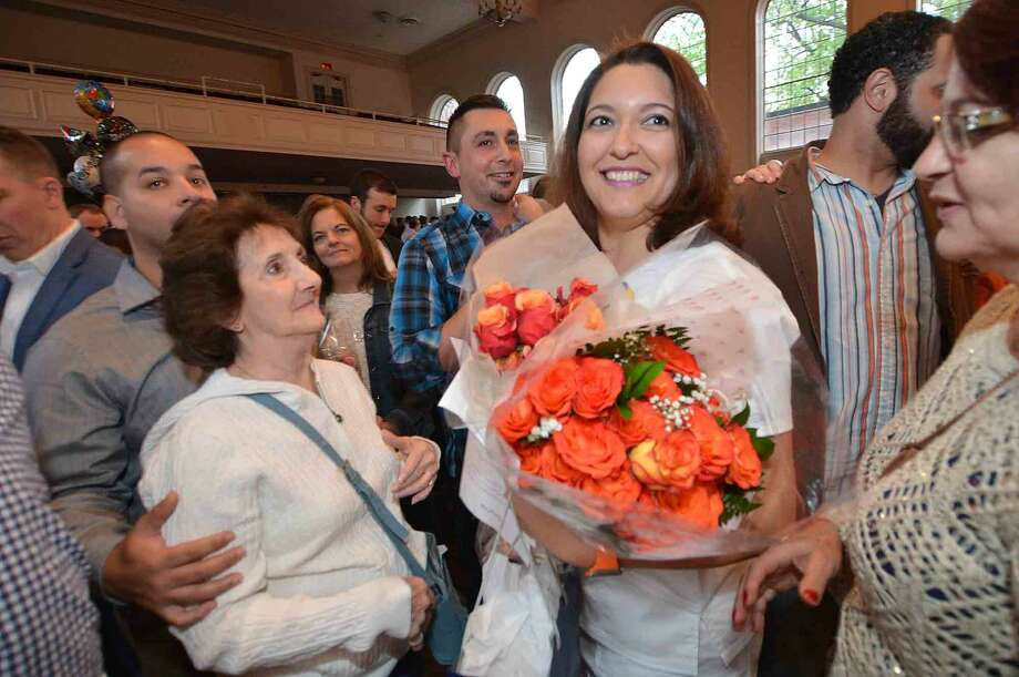 Viviane Brito from Stamford looks for her family during the Norwalk Community College Nursing Class of 2016 Pinning Ceremony at City Hall in Norwalk Conn. Tuesday May 17, 2016