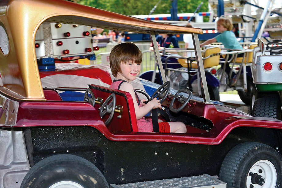 Dylan Dobrydio, 5, enjoys the rides during the 25th annual Rowayton School Carnival Saturday May 14, 2016 at Rowayton Elementary School in Norwalk, Conn. The carnival is one of the top fundraisers for the school and all proceeds from the event support enrichment programs and educational technologies at the school.