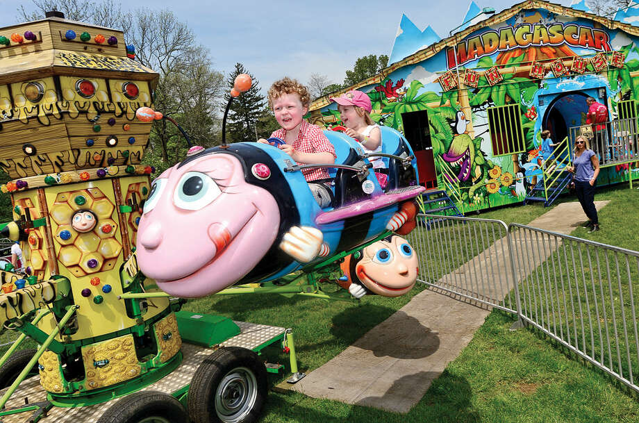 Sebastian Hahn and Wesley Oldrin, both 3, enjoy the rides during the 25th annual Rowayton School Carnival Saturday May 14, 2016 at Rowayton Elementary School in Norwalk, Conn. The carnival is one of the top fundraisers for the school and all proceeds from the event support enrichment programs and educational technologies at the school.