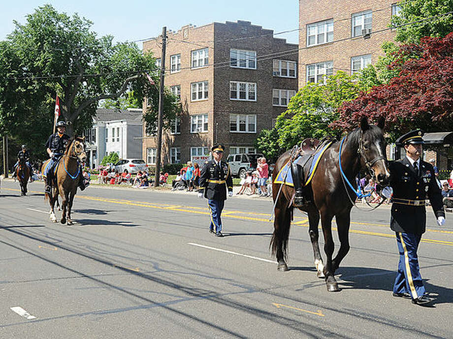 The 2nd Company Governor's Horse Guard with the riderless horse at the 2015 Memorial Day Parade in Norwalk. Hour photo/Matthew Vinci