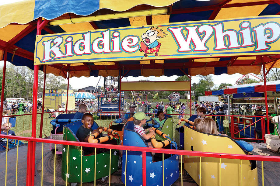 Children enjoy the rides during the 25th annual Rowayton School Carnival Saturday May 14, 2016 at Rowayton Elementary School in Norwalk, Conn. The carnival is one of the top fundraisers for the school and all proceeds from the event support enrichment programs and educational technologies at the school.