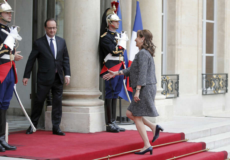 FOR STORY SLUGGED FRANCE PRESIDENT'S EX BY SYLVIE CORBET - In this photo taken Monday, May 18, 2015, French Minister for Ecology, Sustainable Development and Energy Segolene Royal arrives at the Elysee Palace for a meeting with French president Francois Hollande and former U.S. vice President and Environmentalist advocate Al Gore at the Elysee Palace, in Paris. Segolene Royal is the French president's ex-partner and mother of his four children, who is a prominent government minister, and she is increasingly appearing alongside President Hollande during important official functions. (AP Photo/Francois Mori, FILE)