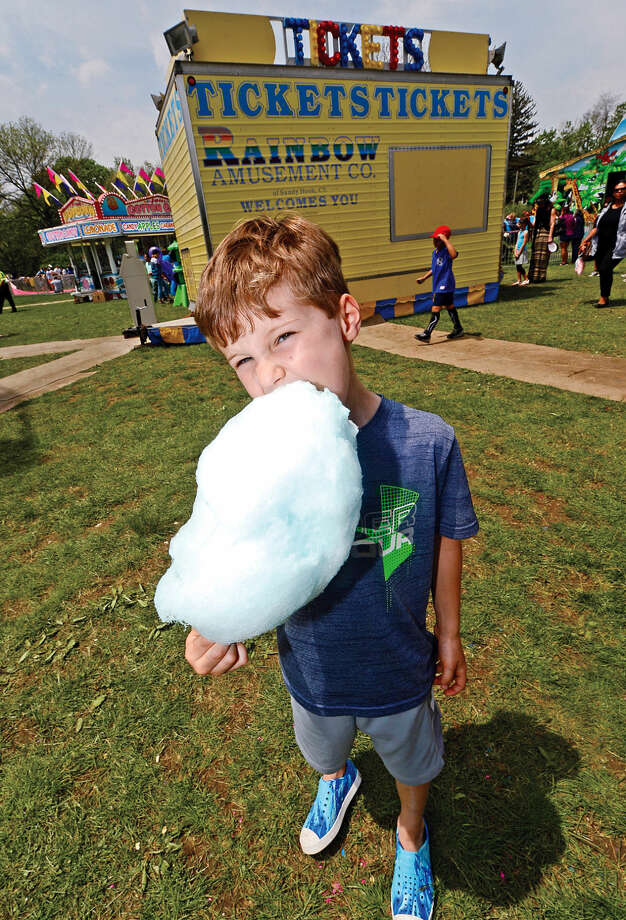 6 year old Liam Hebb enjoys a cotton candy during the 25th annual Rowayton School Carnival Saturday May 14, 2016 at Rowayton Elementary School in Norwalk, Conn. The carnival is one of the top fundraisers for the school and all proceeds from the event support enrichment programs and educational technologies at the school.