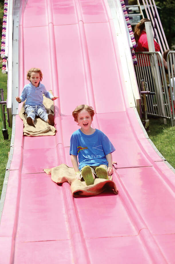 Oliver Oldrin, and Emmett Peek, both 6, enjoy the rides during the 25th annual Rowayton School Carnival Saturday May 14, 2016 at Rowayton Elementary School in Norwalk, Conn. The carnival is one of the top fundraisers for the school and all proceeds from the event support enrichment programs and educational technologies at the school.