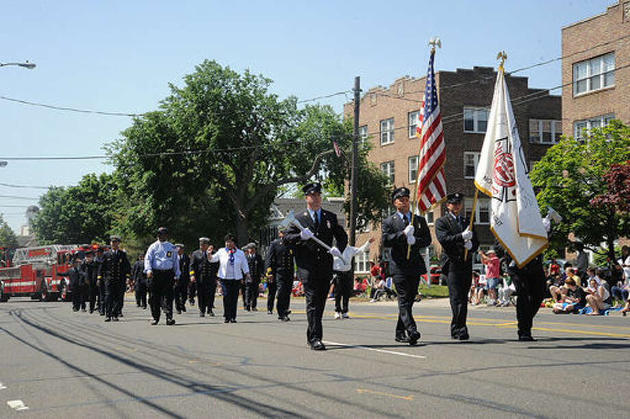 The Norwalk Fire Department at the 2015 Memorial Day Parade in Norwalk. Hour photo/Matthew Vinci