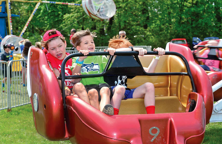 Ace Jernstedt, Charlie Comes and Andrew Burns enjoy the rides during the 25th annual Rowayton School Carnival Saturday May 14, 2016 at Rowayton Elementary School in Norwalk, Conn. The carnival is one of the top fundraisers for the school and all proceeds from the event support enrichment programs and educational technologies at the school.