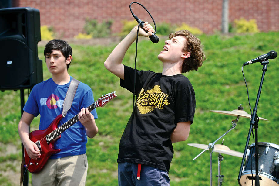 The School of Rock house band including Rodrigo Galavis and Grady Allen plays during the 25th annual Rowayton School Carnival Saturday May 14, 2016 at Rowayton Elementary School in Norwalk, Conn. The carnival is one of the top fundraisers for the school and all proceeds from the event support enrichment programs and educational technologies at the school.