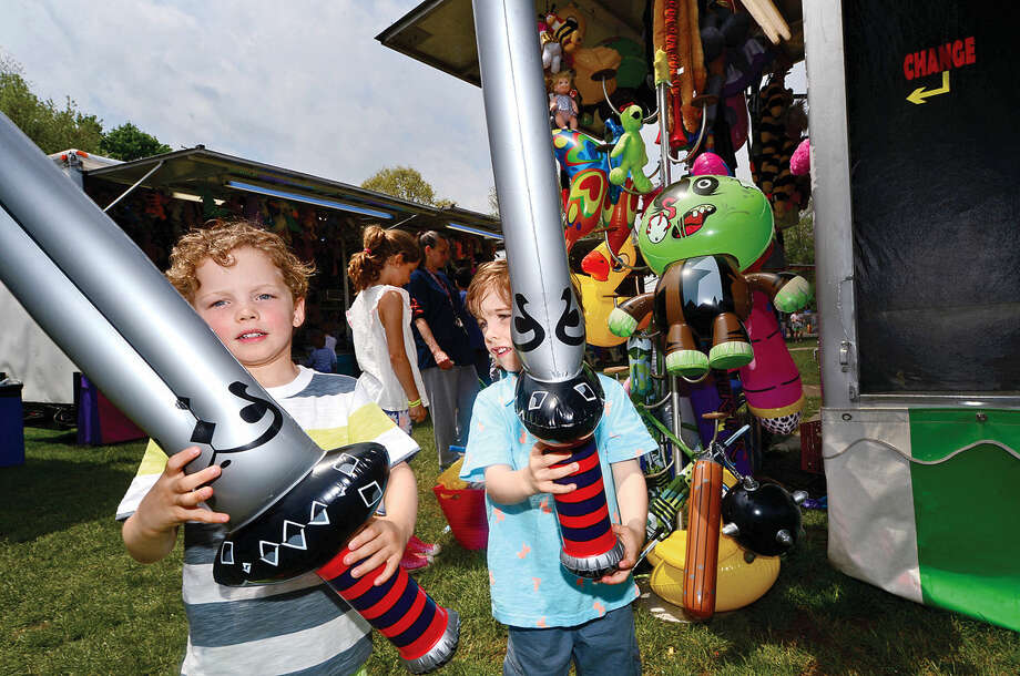 Brian and James Coyle, both 3, carry inflatable swords during the 25th annual Rowayton School Carnival Saturday May 14, 2016 at Rowayton Elementary School in Norwalk, Conn. The carnival is one of the top fundraisers for the school and all proceeds from the event support enrichment programs and educational technologies at the school.