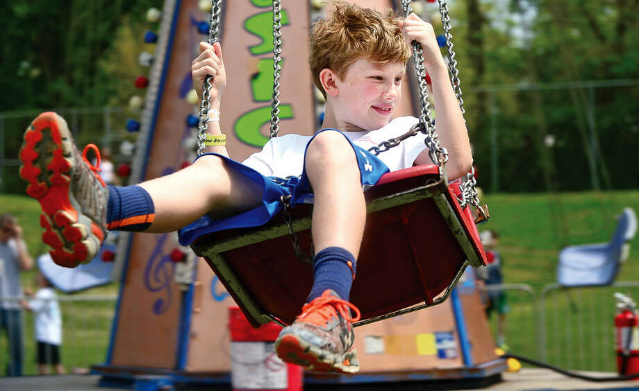 Eamon Boyle, 10, enjoys the rides during the 25th annual Rowayton School Carnival Saturday May 14, 2016 at Rowayton Elementary School in Norwalk, Conn. The carnival is one of the top fundraisers for the school and all proceeds from the event support enrichment programs and educational technologies at the school.