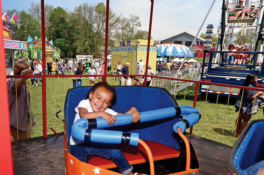 1 year old Gianna Kitt enjoys the rides during the 25th annual Rowayton School Carnival Saturday May 14, 2016 at Rowayton Elementary School in Norwalk, Conn. The carnival is one of the top fundraisers for the school and all proceeds from the event support enrichment programs and educational technologies at the school.