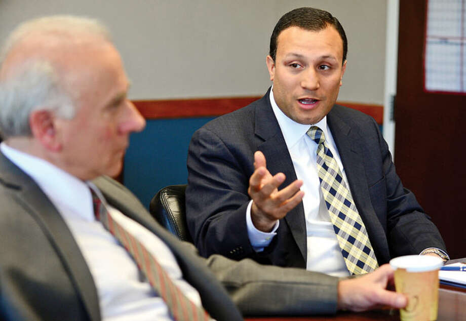 Hour photo / Erik Trautmann Warren A. Pena, SoNo Community Center, Inc., board of directors chairman, and Deputy Director Peter Ferrandino speak to The Hour editorial board Wednesday about his plans as Norwalk Economic Opportunity, Inc., prepares to file for bankruptcy Friday. Patrick Ferrandino ; Warren Pena