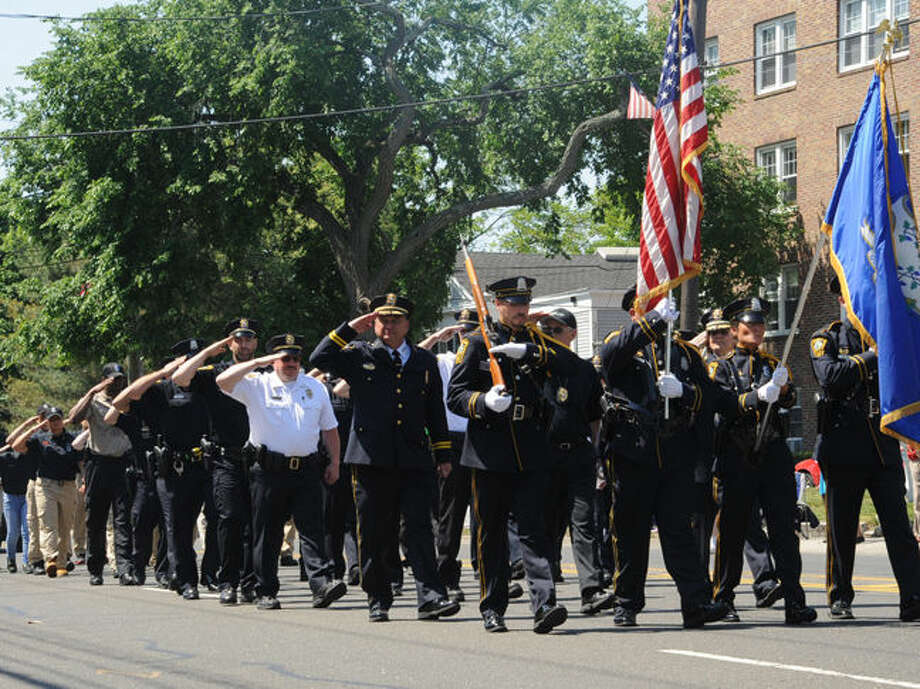 The Norwalk Police Department at the 2015 Memorial Day Parade in Norwalk. Hour photo/Matthew Vinci