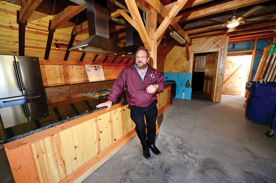 Hour photo / Erik Trautmann Parks and Recreation director Michael Moccaie talks about completing renovations to Fodor Farm.