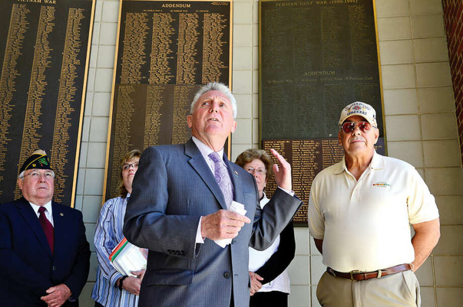 Hour photo / Erik Trautmann Norwalk Mayor Harry W. Rilling and Daniel Caporale, Norwalk Veterans Memorial Committee chairman, announce criteria for soliciting of names of residents to be placed on the Veterans' Plaque outside City Hall during a press conference Wednesday.