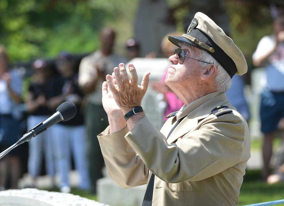 Hour Photo/Alex von Kleydorff Keynote speaker Navy Lt. Jr. Grade (Ret) Jack Majesky looks to the sky as he encorages everyone to applaude those who gave their lives in the service of their country, during a service at Hillside Cemetery in Wilton on Memorial Day