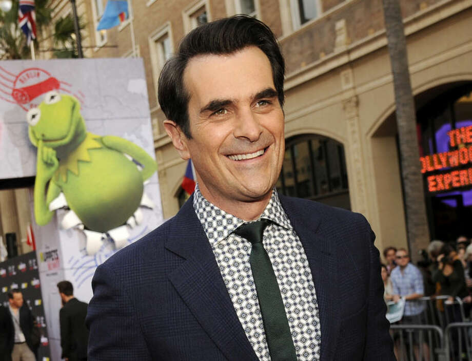 "FILE - This March 11, 2014 file photo shows actor Ty Burrell at the premiere of the film ""Muppets Most Wanted,"" in Los Angeles. Burrell, star of ""Modern Family"" and a St. Louis Rams fan, will participate in the first round of the NFL draft with the team. His main duty will be to hand the team jersey to NFL Commissioner Roger Goodell for the team's 13th pick. The league said Wednesday, May 7, it's the first time a celebrity has taken part in the draft, which starts Thursday at Radio City Music Hall and will run until Saturday. (Photo by Chris Pizzello/Invision/AP, File)"