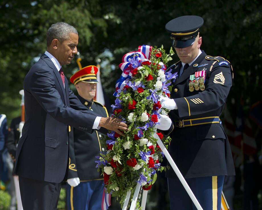 President Barack Obama and with the aid of Sgt. 1st Class John C. Wirth lays a wreath at the Tomb of the Unknowns, on Memorial Day, Monday, May 25, 2015, at Arlington National Cemetery in Arlington, Va. (AP Photo/Pablo Martinez Monsivais)
