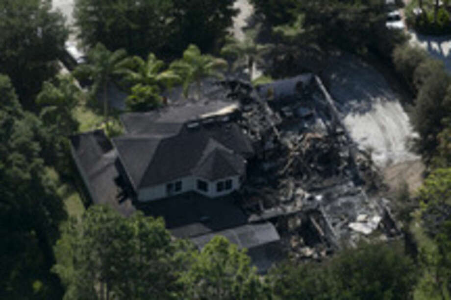 AP photo / The Tampa Bay Times, Eve EdelheitThis aerial photo shows the burned out home on Thursday in Tampa, Fla. Authorities have said they think the fire at the five-bedroom home was intentionally set and that they found fireworks inside the home.