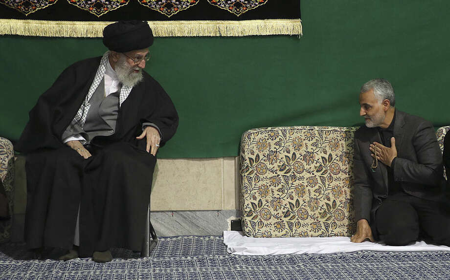 "FILE - In this Friday, March 27, 2015 file photo released by the official website of the office of the Iranian supreme leader, commander of Iran's Quds Force, Qassem Soleimani, right, greets Supreme Leader Ayatollah Ali Khamenei while attending a religious ceremony in a mosque at his residence in Tehran, Iran. The chief of an elite unit in Iran's Revolutionary Guard has accused the U.S. of having ""no will"" to stop the Islamic State group after the fall of the Iraqi city of Ramadi, an Iranian newspaper reported Monday. (Office of the Iranian Supreme Leader via AP, File)"