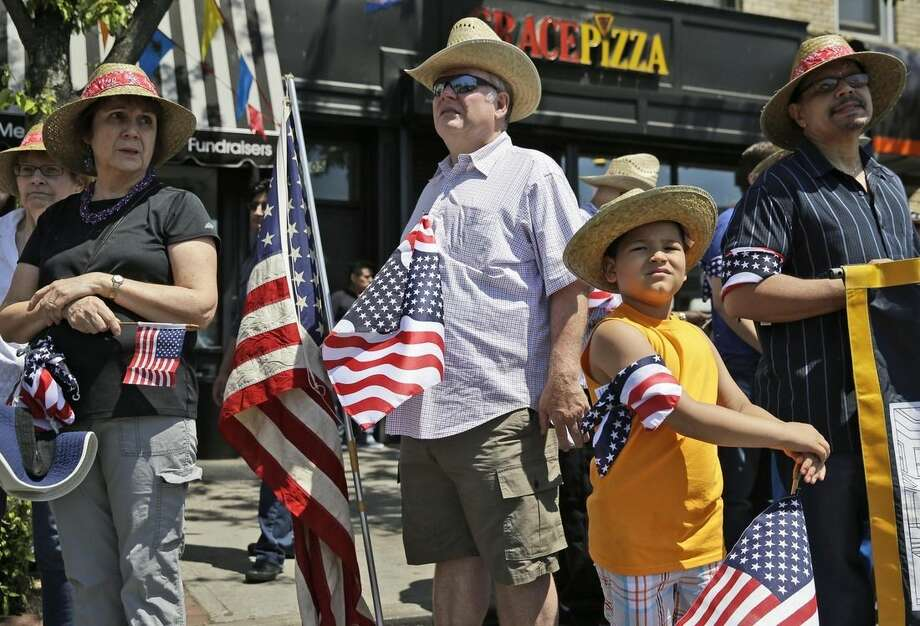 Participants wait for the start of a Memorial Day parade in the Glenwood neighborhood of New York, Monday, May 25, 2015. President Barack Obama saluted Americans who died in battle Monday, noting the first Memorial Day in 14 years without U.S. forces involved in a major ground war. (AP Photo/Seth Wenig)